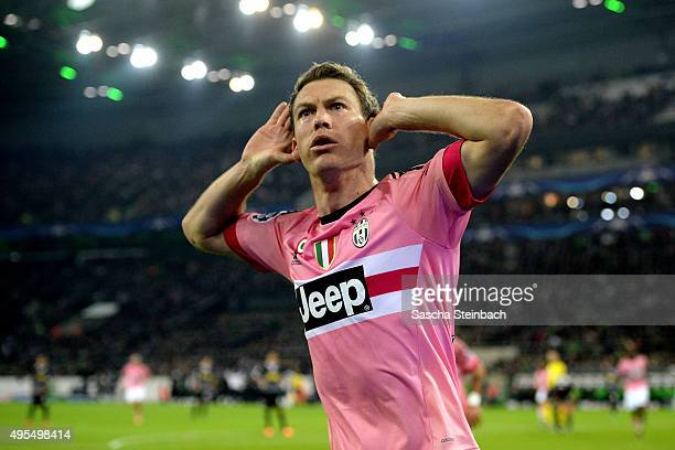 Stephan Lichtsteiner of Juventus celebrates after scoring his team's first goal during the UEFA Champions League group stage match between VfL...