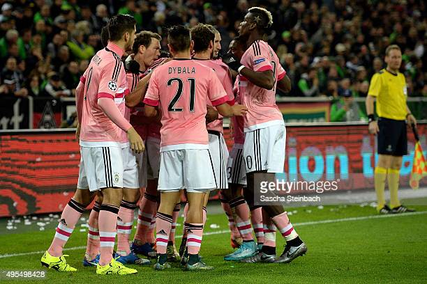 Stephan Lichtsteiner of Juventus celebrates with team mates after scoring his team's first goal during the UEFA Champions League group stage match...