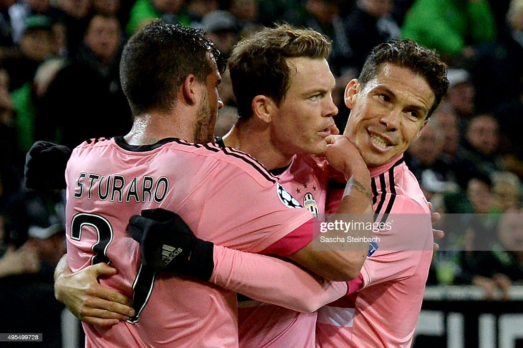 Stephan Lichtsteiner (C) of Juventus celebrates with team mates after scoring his team's first goal during the UEFA Champions League group stage match between VfL Borussia Monchengladbach and Juventus FC on November 3, 2015 in Moenchengladbach, Germany.