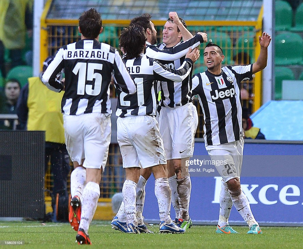 <a gi-track='captionPersonalityLinkClicked' href=/galleries/search?phrase=Stephan+Lichtsteiner&family=editorial&specificpeople=709876 ng-click='$event.stopPropagation()'>Stephan Lichtsteiner</a> (2nd R) of Juventus celebrates with team-mates after scoring the opening goal during the Serie A match between US Citta di Palermo v Juventus FC at Stadio Renzo Barbera on December 9, 2012 in Palermo, Italy.