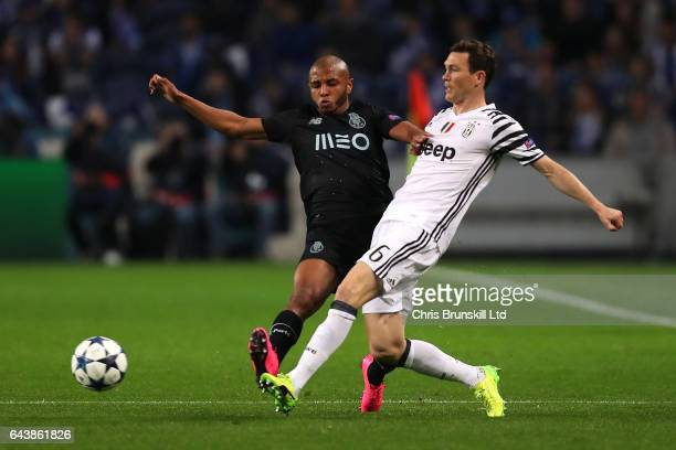 Stephan Lichtsteiner of Juventus competes with Yacine Brahimi of FC Porto during the UEFA Champions League Round of 16 first leg match between FC...