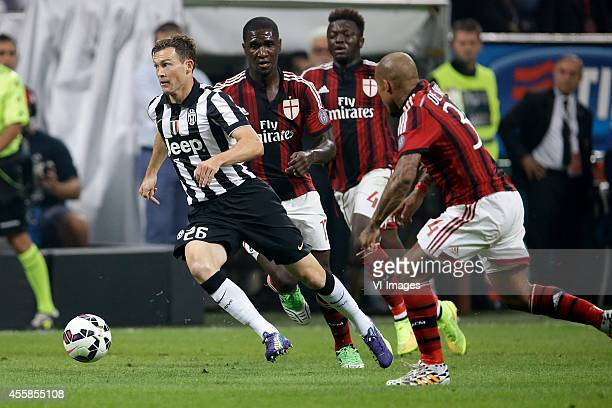 Stephan Lichtsteiner of Juventus Cristian Zapata of AC Milan Sulley Muntari of AC Milan Nigel de Jong of AC Milan during the Serie A match between AC...
