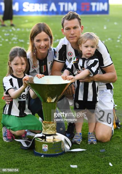 Stephan Lichtsteiner of Juventus FC and family celebrate with the trophy after the beating FC Crotone 30 to win the Serie A Championships at the end...