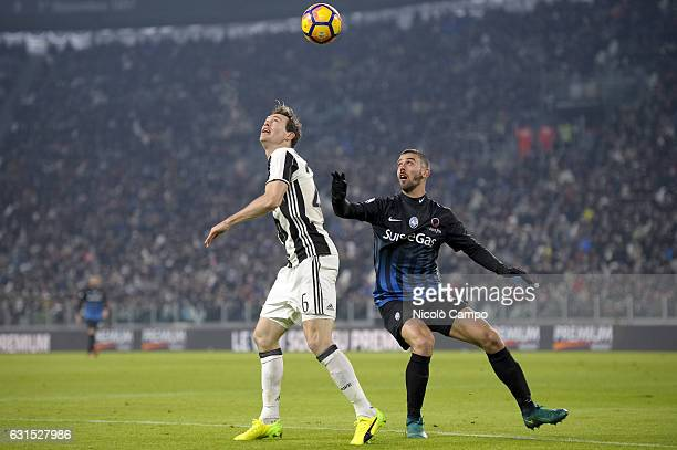 Stephan Lichtsteiner of Juventus FC and Leonardo Spinazzola of Atalanta BC compere for the ball during the TIM Cup match between Juventus FC and...