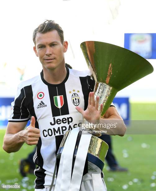 Stephan Lichtsteiner of Juventus FC celebrates with the trophy after the beating FC Crotone 30 to win the Serie A Championships at the end of the...
