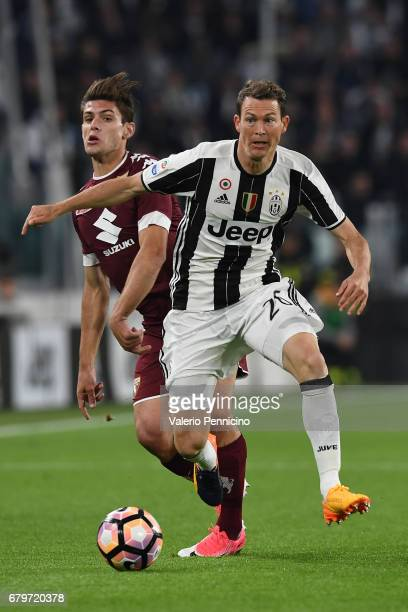 Stephan Lichtsteiner of Juventus FC clashes with Lucas Boye of FC Torino during the Serie A match between Juventus FC and FC Torino at Juventus...