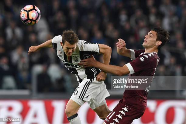 Stephan Lichtsteiner of Juventus FC in action against Lucas Boye of FC Torino during the Serie A match between Juventus FC and FC Torino at Juventus...