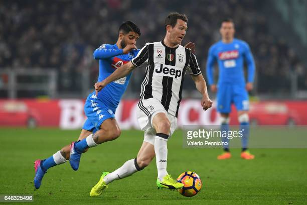 Stephan Lichtsteiner of Juventus FC is challenged by bLorenzo Insigne of SSC Napoli during the TIM Cup match between Juventus FC and SSC Napoli at...