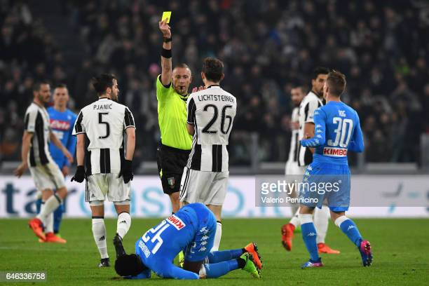 Stephan Lichtsteiner of Juventus FC receives the yellow card from referee Paolo Valeri during the TIM Cup match between Juventus FC and SSC Napoli at...