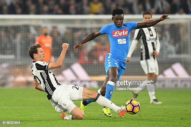 Stephan Lichtsteiner of Juventus FC tackles Amadou Diawara of SSC Napoli during the Serie A match between Juventus FC and SSC Napoli at Juventus...