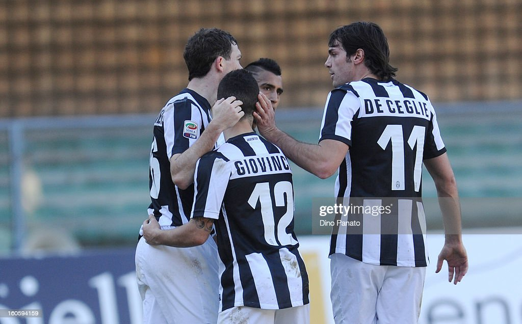 Stephan Lichtsteiner (L) of Juventus is congratulated by team-mates Sebastian Giovinco and Paolo De Ceglie after scoring their team's second goal with team - mates during the Serie A match between AC Chievo Verona and Juventus FC at Stadio Marc'Antonio Bentegodi on February 3, 2013 in Verona, Italy.