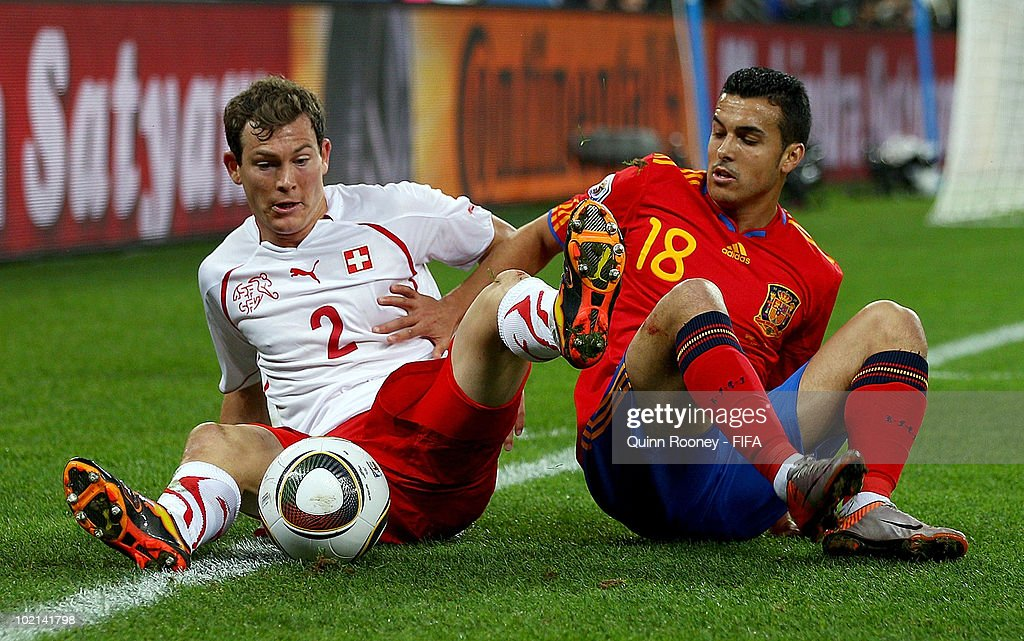 <a gi-track='captionPersonalityLinkClicked' href=/galleries/search?phrase=Stephan+Lichtsteiner&family=editorial&specificpeople=709876 ng-click='$event.stopPropagation()'>Stephan Lichtsteiner</a> of Switzerland and Pedro Rodriguez of Spain battle for the ball during the 2010 FIFA World Cup South Africa Group H match between Spain and Switzerland at Durban Stadium on June 16, 2010 in Durban, South Africa.