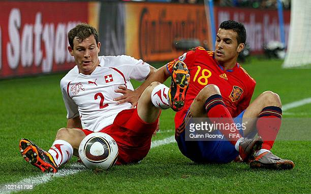 Stephan Lichtsteiner of Switzerland and Pedro Rodriguez of Spain battle for the ball during the 2010 FIFA World Cup South Africa Group H match...