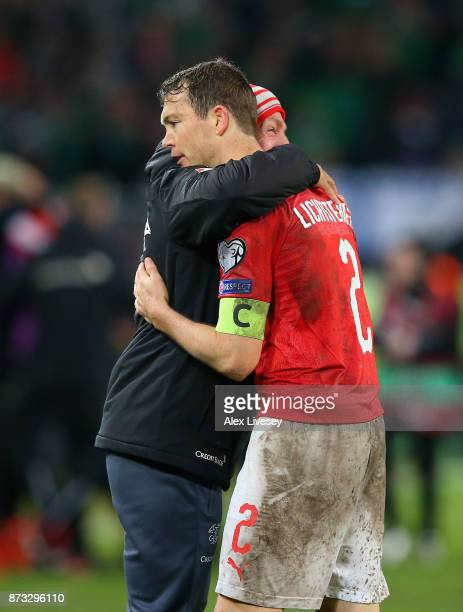 Stephan Lichtsteiner of Switzerland celebrates after his nation qualify for The World Cup following the FIFA 2018 World Cup Qualifier PlayOff Second...