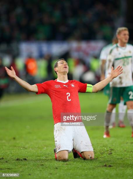 Stephan Lichtsteiner of Switzerland celebrates as his Nation qualify for the World Cup following the FIFA 2018 World Cup Qualifier PlayOff Second Leg...
