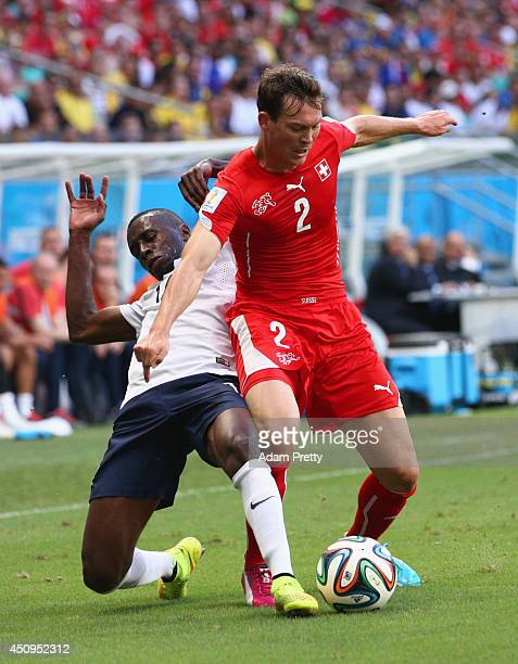 Stephan Lichtsteiner of Switzerland controls the ball against Blaise Matuidi of France during the 2014 FIFA World Cup Brazil Group E match between...