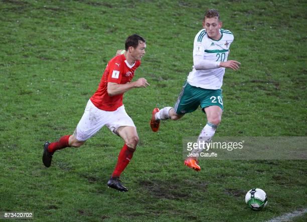 Stephan Lichtsteiner of Switzerland George Saville of Northern Ireland during the FIFA 2018 World Cup Qualifier PlayOff Second Leg between...