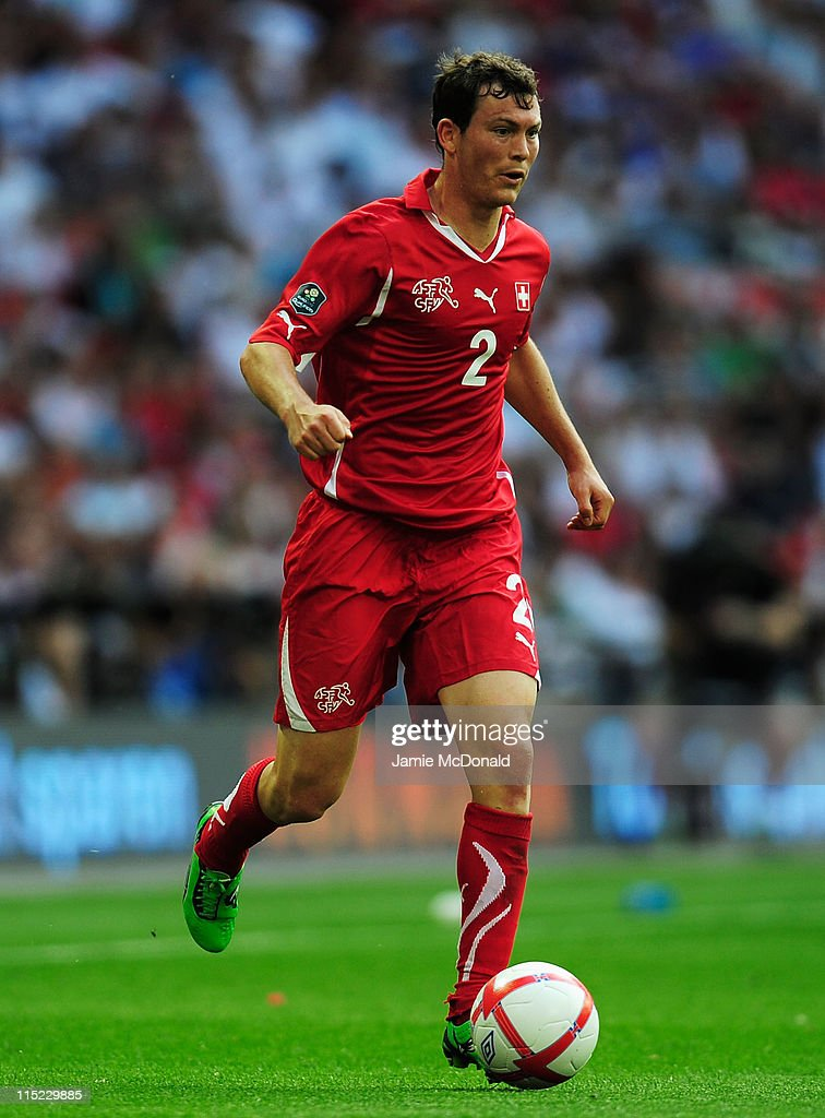 <a gi-track='captionPersonalityLinkClicked' href=/galleries/search?phrase=Stephan+Lichtsteiner&family=editorial&specificpeople=709876 ng-click='$event.stopPropagation()'>Stephan Lichtsteiner</a> of Switzerland in action during the UEFA EURO 2012 group G qualifying match between England and Switzerland at Wembley Stadium on June 4, 2011 in London, England.