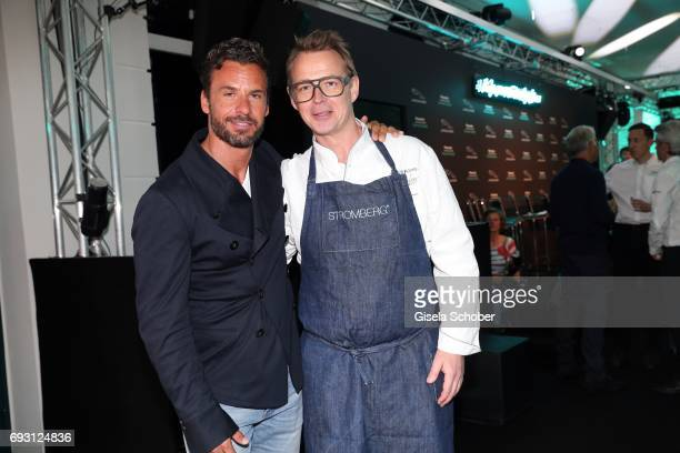 Stephan Luca and star cook Holger Stromberg during the Jaguar Land Rover presentation of the 'IPACE' car concept at Jaguar Land Rover brand boutique...
