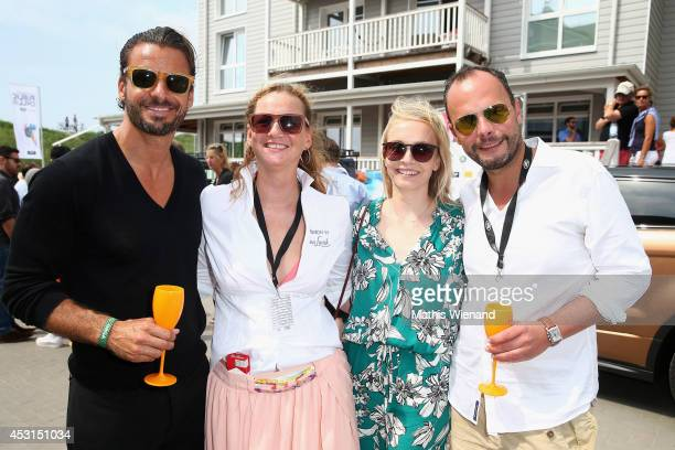 Stephan Luca Jenny Falckenberg Janin Reinhardt and Alexander Franke attend the Land Rover Public Chill 2014 at Beach Motel on August 3 2014 in St...