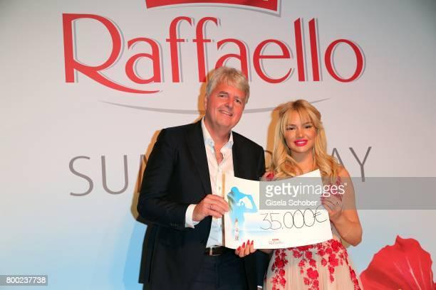 Stephan Niessner Ferrero Germany gives a cheque of 35000 Euro to Shirin David embassador of the foundation 'Herzenswuensche' during the Raffaello...