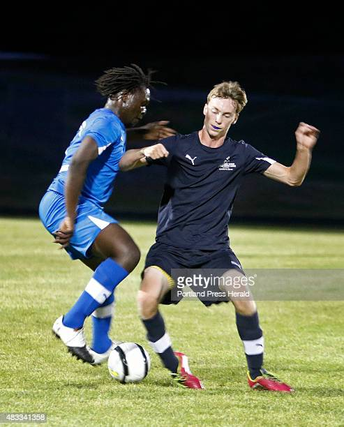 Stephan Ochan of Deering and Joseph Schrader of Fryeburg Academy fight for possession during first half action at high school allstar soccer SMAA vs...