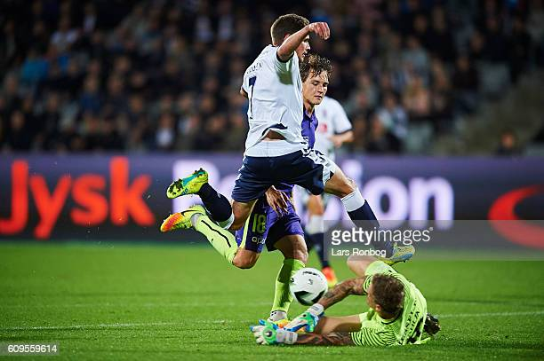 Stephan Petersen of AGF Aarhus and Goalkeeper Johan Dahlin of FC Midtjylland compete for the ball during the Danish Alka Superliga match between AGF...