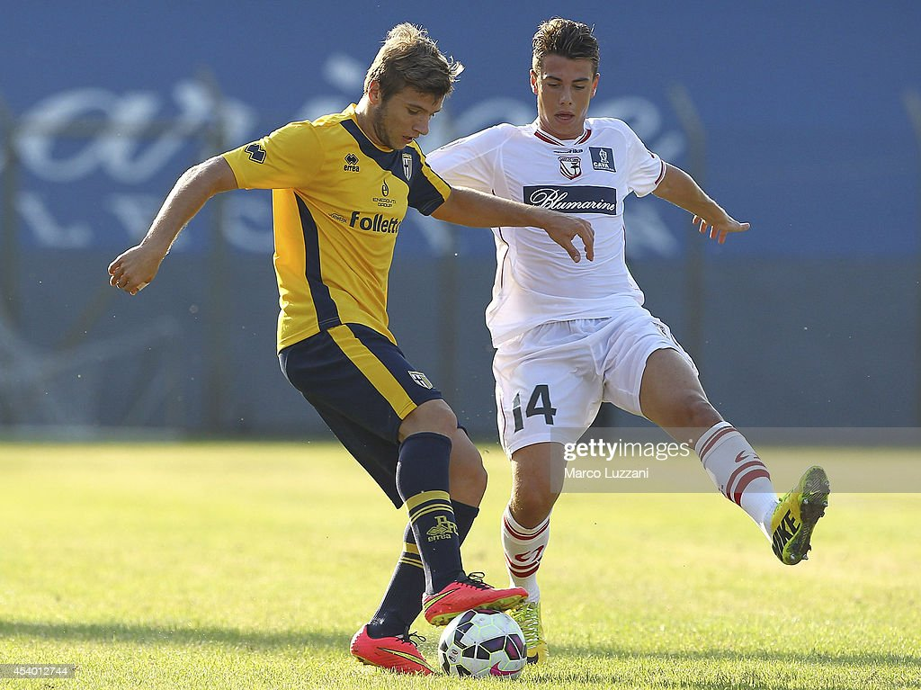 Stephan Ristovski of Parma competes for the ball with Massimiliano Gatto of Carpi FC at Stadio Sandro Cabassi on August 23, 2014 in Carpi, Italy.