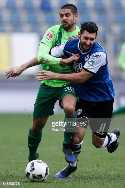 Stephan Salger of Bielefeld and Dimitrij Nazarov battle for the ball during the Second Bundesliga match between DSC Arminia Bielefeld and FC...