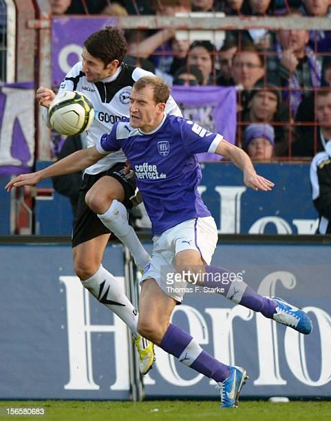 Stephan Salger of Bielefeld tackles Sebastian Neumann of Osnabruck during the Third League match between between VfL Osnabrueck and Arminia Bielefeld...