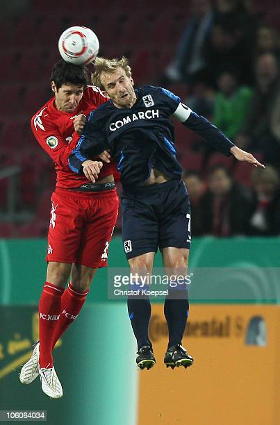 Stephan Salger of Koeln and Daniel Bierofka of Muenchen go up for a header during the DFB Cup match 1 FC Koeln and 1860 Muenchen at RheinEnergie...