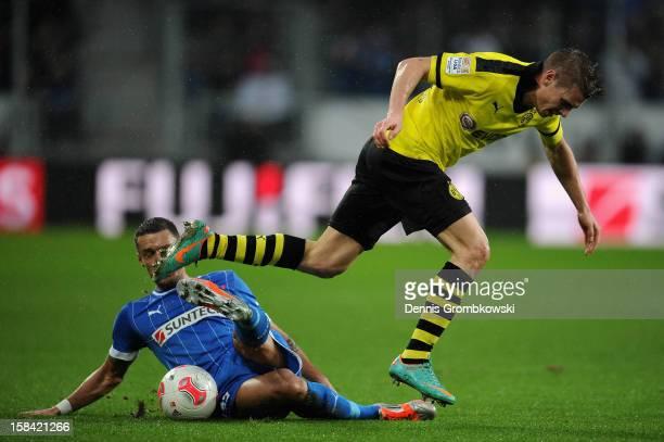 Stephan Schroeck of Hoffenheim challenges Lukasz Piszczek of Dortmundduring the Bundesliga match between TSG 1899 Hoffenheim and Borussia Dortmund at...