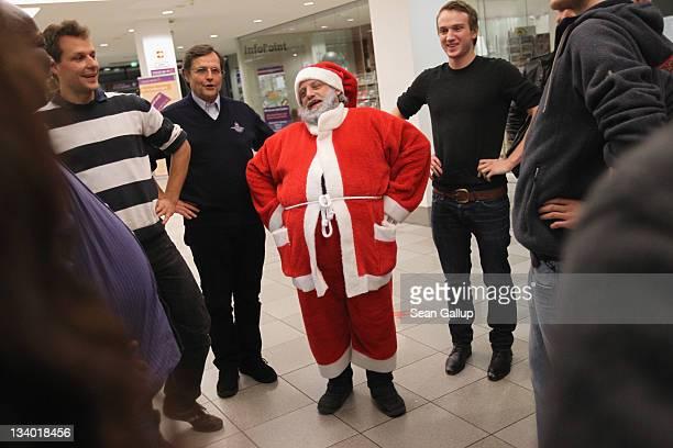 Stephan 'Stippi' Antczack alias Santa Claus leads Santastobe in a theatrical exercise as part of his Santa workshop at the Studentenwerk Berlin on...