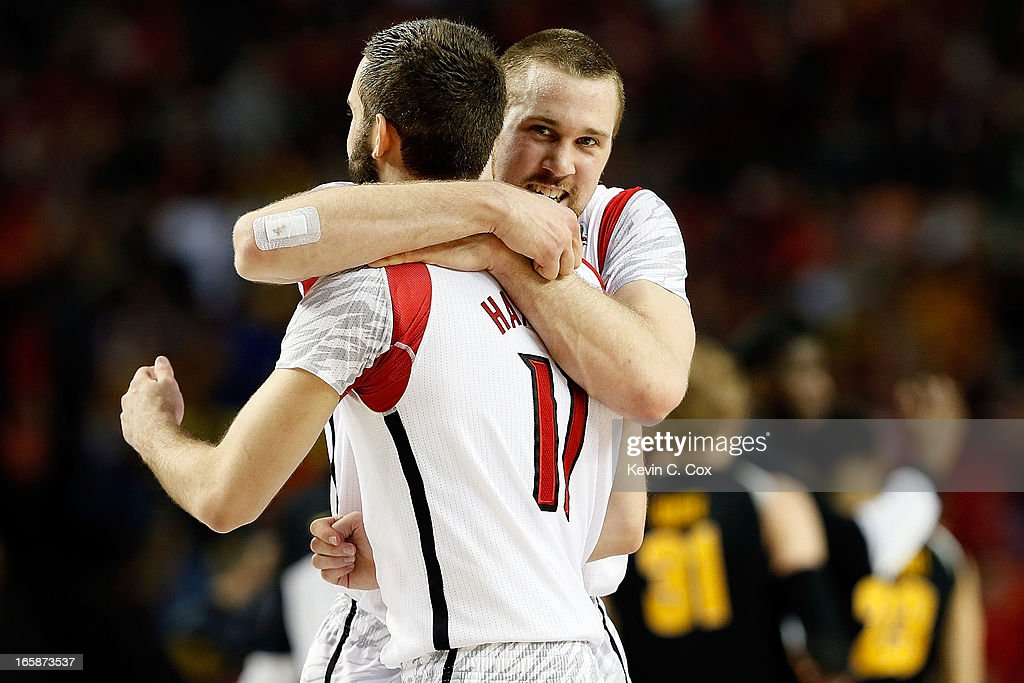 Stephan Van Treese #44 hugs Luke Hancock #11 of the Louisville Cardinals after the Cardinals defeat the Wichita State Shockers 72-68 in the 2013 NCAA Men's Final Four Semifinal at the Georgia Dome on April 6, 2013 in Atlanta, Georgia.