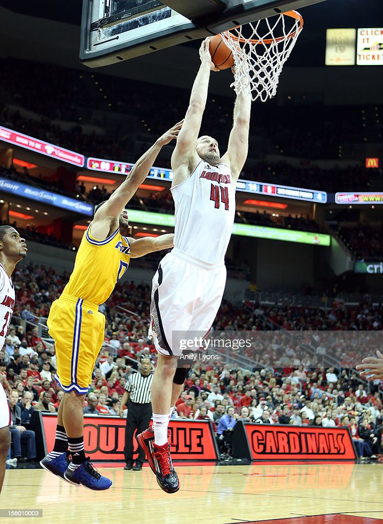 Stephan Van Treese #44 of the Louisville Cardinals dunks the ball during the game against the Missouri-Kansas City Kangaroos at KFC YUM! Center on December 8, 2012 in Louisville, Kentucky.