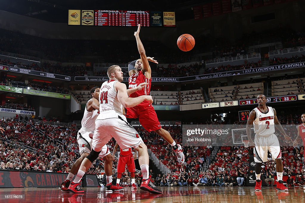 Stephan Van Treese #44 of the Louisville Cardinals knocks the ball away from Jackie Carmichael #32 of the Illinois State Redbirds during the game at KFC Yum! Center on December 1, 2012 in Louisville, Kentucky. Louisville won 69-66.