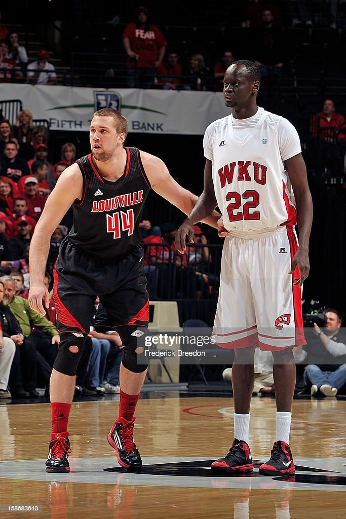 Stephan Van Treese #44 of the Louisville Cardinals plays against Teeng Akol #22 of the Western Kentucky Hilltoppers at Bridgestone Arena on December 22, 2012 in Nashville, Tennessee.