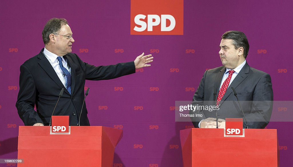 Stephan Weil, candidate in Lower Saxony for the German Social Democrats (SPD), and SPD Chairman Sigmar Gabriel speak to the media during a press conference the day after the SPD and German Greens party emerged with a hairline victory in Lower Saxony on January 21, 2013 in Berlin, Germany. The win has given the SPD a much needed boost following declining popularity figures for its chancellor candidate Peer Steinbrueck. Germany faces national elections later this year.