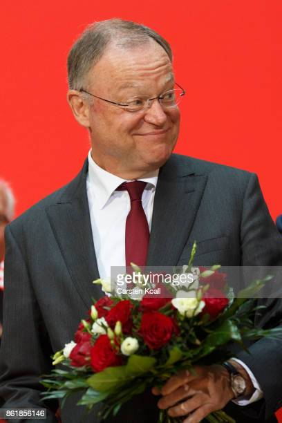 Stephan Weil incumbent SPD candidate in yesterday's state elections in Lower Saxonyholds flowers at SPD headquarters on October 16 2017 in Berlin...