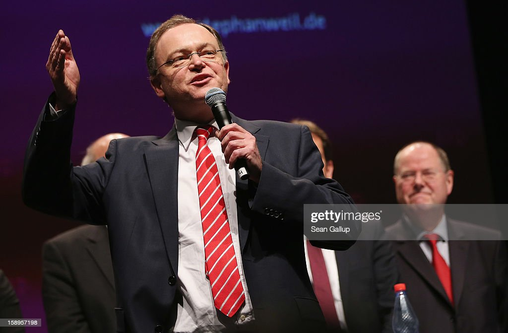 Stephan Weil (L), Mayor of Hanover and gubernatorial candidate of the German Social Democrats (SPD) in elections in Lower Saxony, speaks during an SPD state election rally as <a gi-track='captionPersonalityLinkClicked' href=/galleries/search?phrase=Peer+Steinbrueck&family=editorial&specificpeople=209110 ng-click='$event.stopPropagation()'>Peer Steinbrueck</a>, chancellor candidate of the SPD, looks on on January 4, 2013 in Emden, Germany. Lower Saxony is holding state elections on January 20 and many analysts see the election as a bellwether for national elections, in which Steinbrueck will run for chancellor, scheduled to take place later this year.