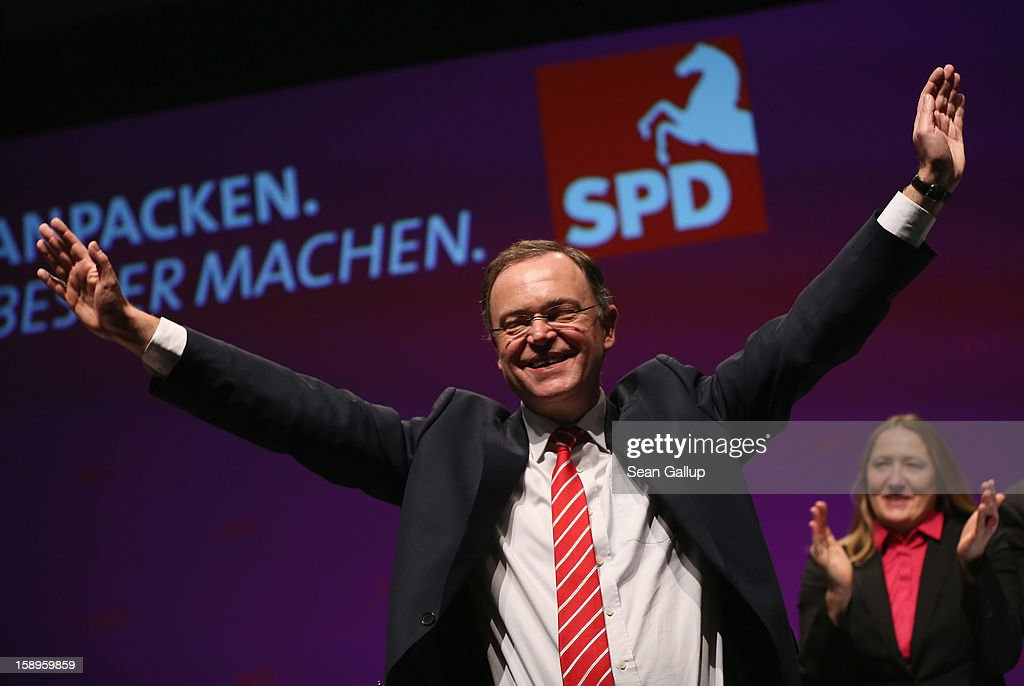 Stephan Weil, Mayor of Hanover and gubernatorial candidate of the German Social Democrats (SPD) in elections in Lower Saxony, waves at the conclusion of an SPD state election rally on January 4, 2013 in Emden, Germany. Lower Saxony is holding state elections on January 20 and many analysts see the election as a bellwether for national elections scheduled to take place later this year.