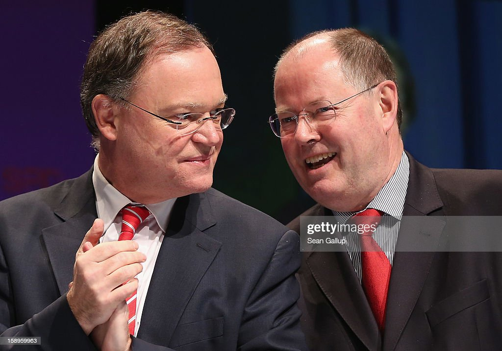 Stephan Weil (L), Mayor of Hanover and gubernatorial candidate of the German Social Democrats (SPD) in elections in Lower Saxony, and <a gi-track='captionPersonalityLinkClicked' href=/galleries/search?phrase=Peer+Steinbrueck&family=editorial&specificpeople=209110 ng-click='$event.stopPropagation()'>Peer Steinbrueck</a>, chancellor candidate of the SPD, attend an SPD state election rally on January 4, 2013 in Emden, Germany. Lower Saxony is holding state elections on January 20 and many analysts see the election as a bellwether for national elections, in which Steinbrueck will run for chancellor, scheduled to take place later this year.