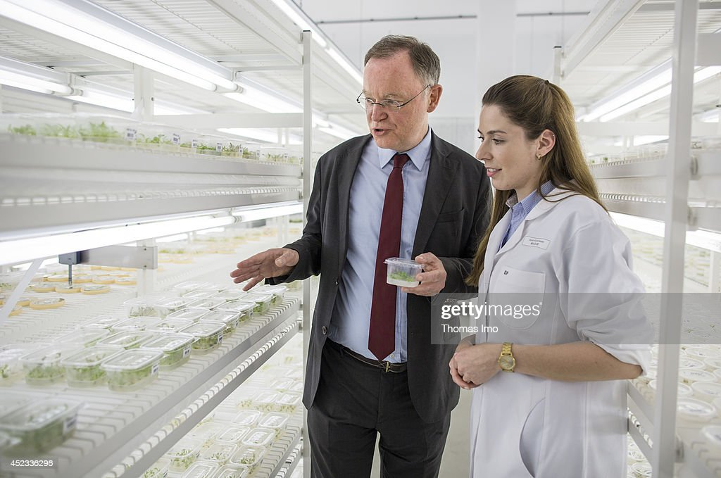 Stephan Weil, Prime Minister of German State Lower-Saxony, talks to an employee in the research laboratory at seed manufacturer KWS SAAT AG as part of his summertour through lower saxony on July 18, 2014 in Einbeck, Germany.