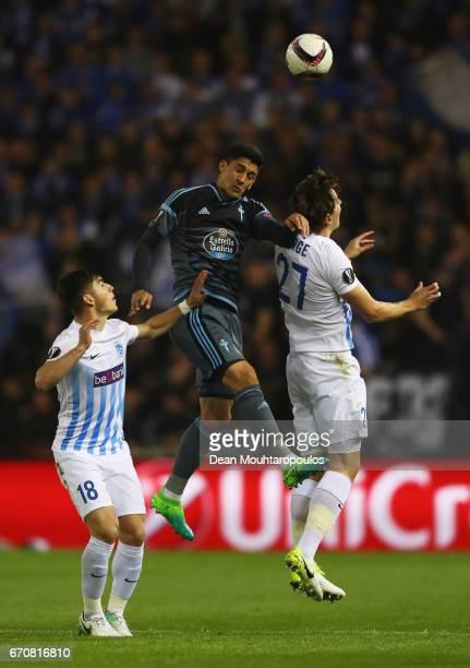 Stephane Badji of RSC Anderlecht jumps between Daniel Wass and Ivan Villar of Celta Vigo during the UEFA Europa League quarter final second leg...