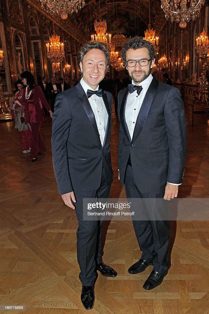 Stephane Bern (L) and Cyril Vergniol pose in the Hall of Mirrors as they attend the gala dinner of Professor David Khayat's association 'AVEC', at Chateau de Versailles on February 4, 2013 in Versailles, France.