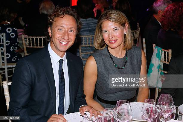 Stephane Bern and Helene Fulgence attend 'Friends of Quai Branly Museum Society' dinner party at Musee du Quai Branly on September 9 2013 in Paris...