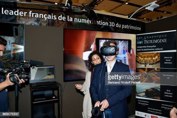 Stephane Bern trying a 'Virtual Visit' during the Official Visit of Stephane Bern at the 'International Exhibition of Cultural Heritage Salon...