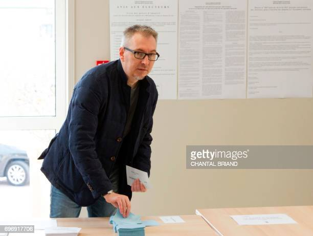 Stephane Claireaux representative of French Overseas Minister Annick Girardin arrives to vote at a polling station in SaintPierre in the French...