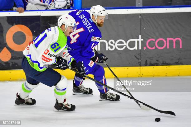 Stephane Da Costa of France and Jury Repe of Slovenia during the EIHF Ice Hockey Four Nations tournament match between France and Slovenia on...