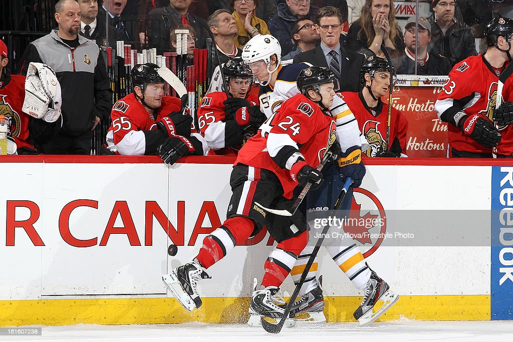 Stephane Da Costa #24 of the Ottawa Senators checks <a gi-track='captionPersonalityLinkClicked' href=/galleries/search?phrase=Tyler+Myers&family=editorial&specificpeople=4595080 ng-click='$event.stopPropagation()'>Tyler Myers</a> #57 of the Buffalo Sabres along the boards, during an NHL game at Scotiabank Place on February 12, 2013 in Ottawa, Ontario, Canada.